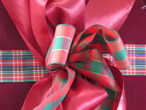 Box of Christmas present wrapped with ribbons. Royalty Free Stock Image