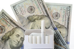 Box cigarette on dollars Royalty Free Stock Images