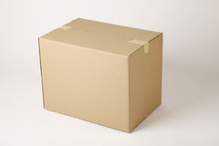 Box. Closed cardboard box taped up and  on a white background Stock Images