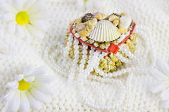 Box from cockleshells and beads of pearls Stock Image