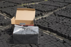 Box of  coconut shell charcoal for shisha Royalty Free Stock Image