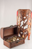 Box with coins and african mask Stock Images