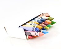 Box of Colored Crayons. A white box of colored crayons Stock Photography