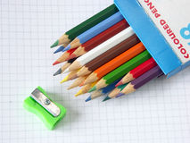 Box of colored pencils and sharpener Stock Photography