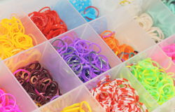 Box with colored rubber bands Royalty Free Stock Photos