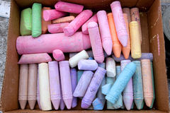Box Of Colorful Chalk Being Used For Sidewalk Art Royalty Free Stock Photography