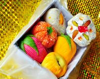 Box of Colorful homemade diwali sweets Stock Photo