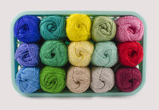 Box with colorful knitting yarn. Beautiful box full of knitting yarn of different colors. Isolated. Close up. From above Royalty Free Stock Image