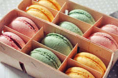 Box with colorful macaroons. On light background closeup Stock Image