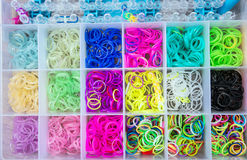 Box with colorful rubber bands for rainbow loom Royalty Free Stock Photo
