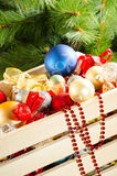 Box with colourful Christmas decorations Royalty Free Stock Images