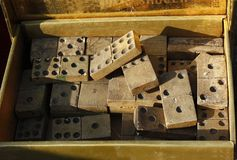 Vintage domino game with wooden pieces in a box royalty free stock image