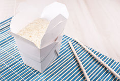 Box with cooked rice Stock Images