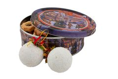 Round box with cookies. Box of cookies and New Year`s toys on a white background Royalty Free Stock Images