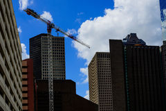 Box crane in downtown houston. Against a cloudy sky Stock Photography