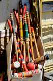 Box of croquet mallets and balls. A cardboard box of croquet mallets and balls for sale at a yard sale Stock Photos