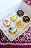 Box of cup cakes in take away carrying box Royalty Free Stock Photography