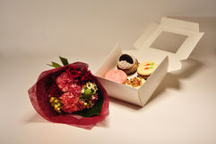A box of cupcakes with flowers Stock Images
