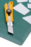 Box Cutter Knife just Cutting white paper Royalty Free Stock Photo
