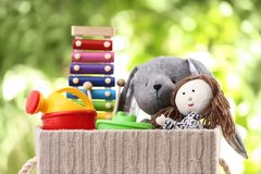 Box with different child toys. On blurred background royalty free stock photo