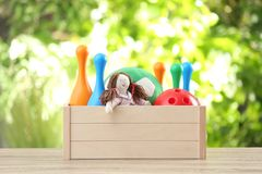 Box with different child toys on table. Against blurred background royalty free stock photography