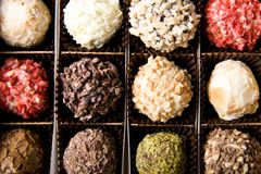Box of different luxury handmade chocolates royalty free stock photos