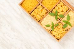 Box with different types of pasta on marble background royalty free stock photo