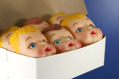 Box of Doll Faces Stock Image