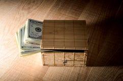 Box with dollar bills Stock Photos