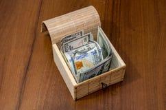Box with dollar bills Royalty Free Stock Photo