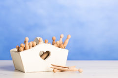 Box Of Dolly Pegs Royalty Free Stock Image