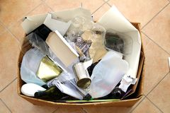 Box of domestic packaging waste ready for recycling. Recycling domestic waste is essential for an environmentally friendly lifesty. Le Royalty Free Stock Image
