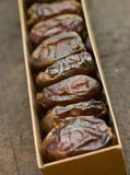 Box of Dried Dates. In a line Stock Image