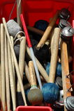 Box of drum sticks. Various drum sticks and samba band musical instruments in a red box Stock Image