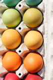 A box of dyed eggs Stock Photo