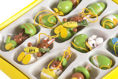 Box of easter decorations. Box filled with wooden easter decorations stock images