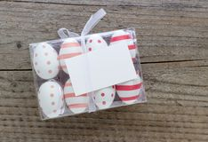 Box of Easter eggs. With dots and stripes and copy space royalty free stock photos