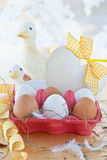 Box of eggs and easter decorations Stock Photography