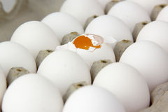 Box of eggs. One cracked. Royalty Free Stock Photos