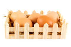 Box of eggs on straw in a wooden box Stock Photography