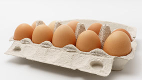 Box of eggs on a white background.  Royalty Free Stock Photos