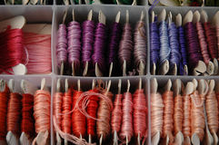 Box of embroidery thread. Various colors of thread stock photos