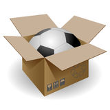 Box end ball. Ball in a cardboard box on a white background Stock Photo