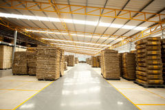 Box factory. Brown cardboard box pile folded in factory building Stock Image