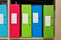 Box files. Selection of colorful box files in a home office Royalty Free Stock Images