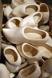 Box filled with clogs. Wooden shoes in box stock photo
