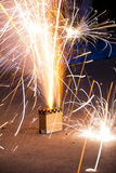 Box fireworks streaming out gold and white sparks Royalty Free Stock Image