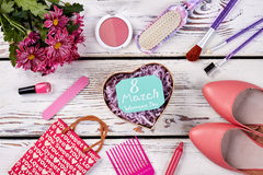 Box, flowers and cosmetics. Royalty Free Stock Photography
