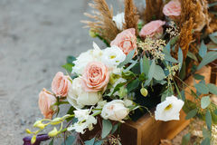 Box with flowers on the ground. Wedding decorations.  Royalty Free Stock Photo