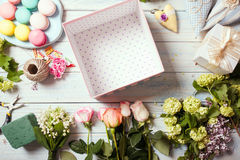 Box with flowers and macaroons Stock Images